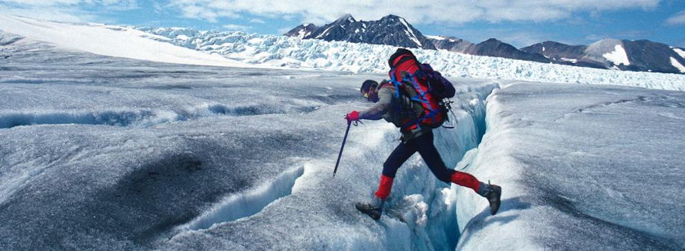 Crossing a crevasse on the Juneau icefield